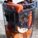 Purple kale smoothie ingredients in pitcher