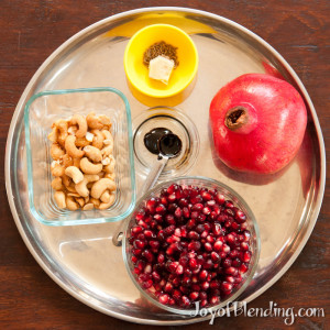Ingredients on plate: pomegranate, cashews, tamarind paste, ginger, can cumin