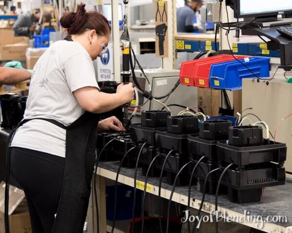 Vitamix factory worker assembling bases