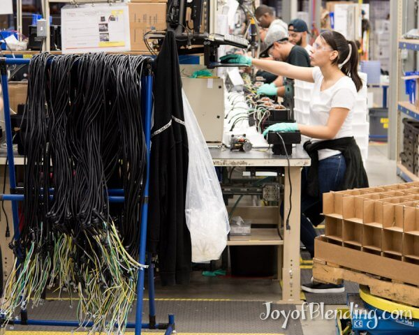 Rack of Vitamix cords and view down the production line